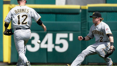 Pittsburgh Pirates shortstop Clint Barmes (12) and left fielder Nate McLouth (2) chase down a double by Detroit Tigers' Prince Fielder that landed between them in the seventh inning on Sunday.
