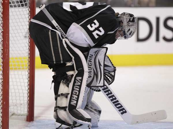 Kings goalie Jonathan Quick meditates during a break in the action of Game 4 against the Coyotes on Sunday afternoon at Staples Center.