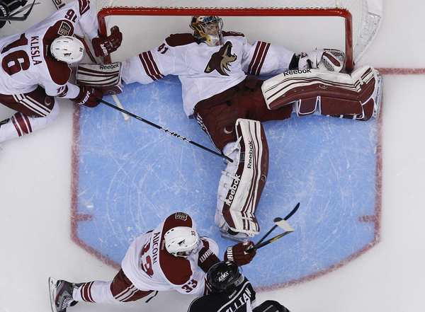Coyotes goalie Mike Smith spreads out to stop a Kings shot in the second period of Game 4 on Sunday afternoon at Staples Center. Smith turned away 36 shots for a 2-0 victory, his third shutout of the postseason.