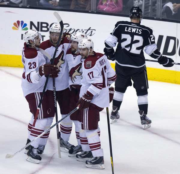Coyotes captain Shane Doan, second from right, is congratulated by teammates Oliver Ekman-Larsson (23), Martin Hanzal (11) and Radmin Vrbata (17) after scoring in the first period of Game 4 on Sunday afternoon.