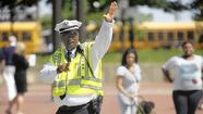 As traffic officer Bobby Brown began his weekday afternoon shift at Pratt and Light streets, he was quickly drawn into the dangerous dance involving pedestrians and motorists.