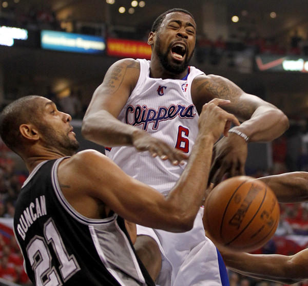 Clippers center DeAndre Jordan is blocked by the Spurs Tim Duncan