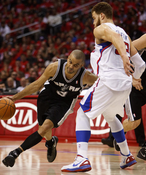 Spurs guard Tony Parker attempts to drive around the Clippers Blake Griffin in the early going of Game 4.