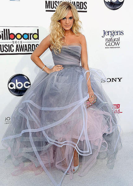 "Carrie Underwood pulled out all the stops for the Billboard Music Awards, donning a pouf-tastic gray Oscar de la Renta ball gown. It seems pretty fancy, but at least she's not Miley - who's wearing nothing but a suit jacket, like a trendy flasher.<BR><BR><i>-- <a href=""http://twitter.com/andrealeigh203"">Andrea Reiher</a>, <a href=""http://www.zap2it.com"">Zap2it</a></i>"