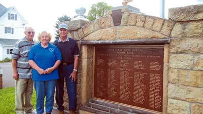 Veterans Memorial Committee members (from left) Blair Younkin, Linda Marker and Charles Kreger invite all veterans and their families to attend the Veterans Memorial Dedication and Honor Roll Rededication Ceremony at 2:30 p.m. Sunday at the Kingwood Church of God.