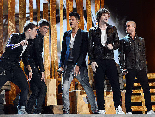 Billboard Music Awards 2012: Best and worst moments: The 2012 British boy-band invasion continued as The Wanted took the stage to perform their two singles, Chasing the Sun and Glad You Came. The five guys went with a monochromatic look, each sporting a different variation on the black jacket/skinny jean outfit (this is different from their red carpet arrival suits, which were also grays and blacks, because they changed into jeans and motorcycle jackets).   Unfortunately, this new era of boy bands does not include choreography (aside from three of them jumping off different points of the stage at the same time). Frankly, it was a little weird seeing them follow each other around the stage, but they sounded awesome and were definitely singing the songs live, so we cant be picky.   -- Jean Bentley, Zap2it