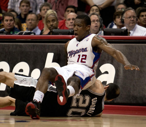 Clippers guard Eric Bledsoe collides with Spurs guard Manu Ginobili