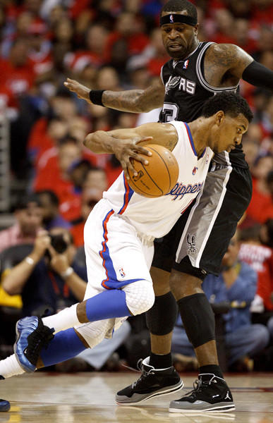 Clippers Nick Young drives into the Spurs Stephen Jackson.