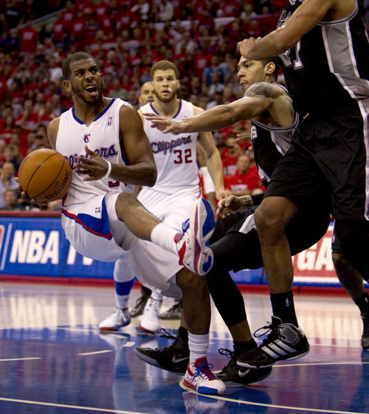 Chris Paul slips before attempting a last-second shot that wouldn't fall. The Clippers lost Game 4 102-99, and the Spurs will advance to the Western Conference Finals.