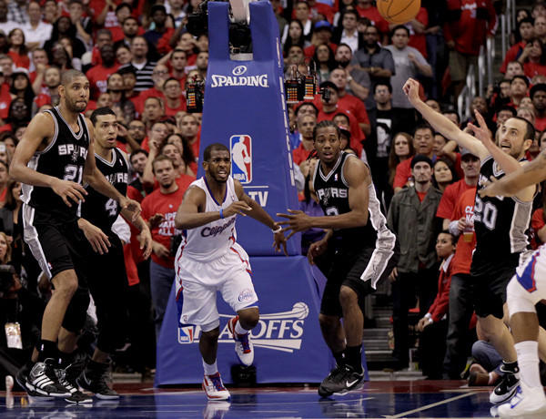 Spurs guard Manu Ginobili, Clippers forward Caron Butler and guard Chris Paul scramble for the loose ball in the final minute of Game 4.
