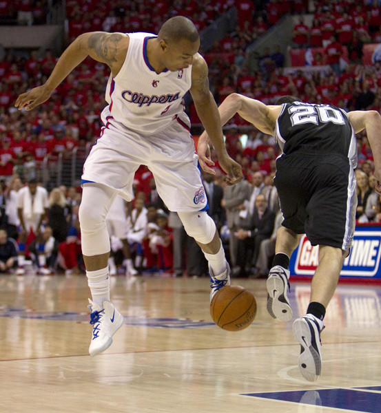 The ball bounced off of Caron Butler's foot, but the Clippers couldn't recover it. The Spurs gained possession and Danny Green was fouled with 10 seconds remaining in the game.