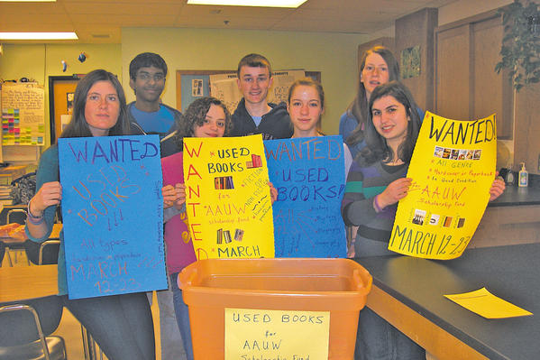 Lilit Mamulyan, an exchange student from Armenia at Boonsboro High School, conducted a book drive for the annual American Association of University Women (AAUW) used book sale. Those shown who helped kick off the book drive are Boonsboro High Fellowship of Christian Athletes, from left, Zoe Chapelle, Steven Kurapaty, Maria Rockford, Shawn Snyder, Ella Hawkins, Mariah Chapelle and Mamulyan.