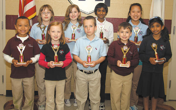 Trophy winners in Grace Academy's spelling bee included, front row, from left, Nathaniel Ferguson, Emma Smith, Thomas Fink, Ethan Enterline and Rachel Rao; back row: Morgan Faith, Jenna Wingert, Shekinah Kurapaty and Taylor Smith,