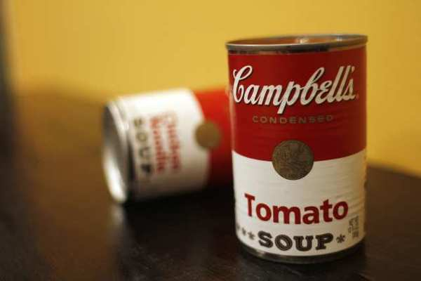 Campbell Soup Co.'s net income slipped by 5.3% in the latest quarter as it struggled to deal with higher costs for ingredients and sluggish soups sales, the company said Monday.