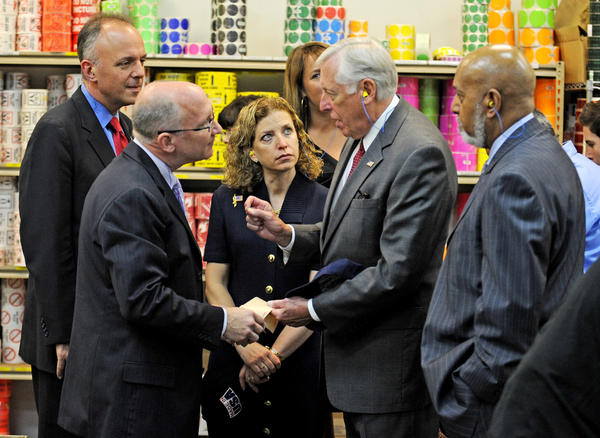 David Perlman, owner of A & M Tape & Packaging in Sunrise along with Democratic leaders Ted Deutch, Debbie Wasserman Schultz and Alcee Hastings, listen to U.S. House Democratic Whip Steny Hoyer (center), as they take a tour of the family run business that manufactures cardboard shipping boxes. Democrats are working to enact the Make It In America agenda: a plan to rebuild American manufacturing and create well-paying jobs.