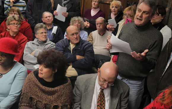 Dan Taylor, right, speaks during a meeting at the Crete Village Hall January 23, 2012. The village is deciding whether to bring an immigrant detention center to town. Terrence Antonio James, Chicago Tribune