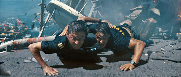 "In this film publicity image released by Universal Pictures, Tadanobu Asano, left, and Taylor Kitsch are shown in a scene from ""Battleship."""