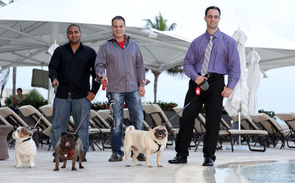 "Luis Hernandez, left, Jason Katsoulis and David Sardina promote PetSet's ""Moonlight and Martinis,"" which takes place on May 31 at the Ritz-Carlton Fort Lauderdale and benefits The Humane Society of Broward County."