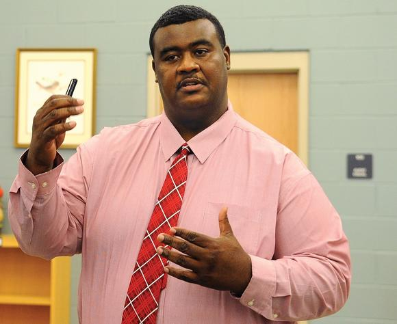 Robbie Graham makes a point after being introduced as girls basketball coach at George Rogers¿Clark High School Monday afternoon. Graham has spent the past seven seasons as assistant boys basketball coach at the school under Scott Humphrey.