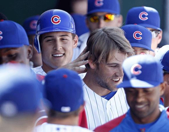 Anthony Rizzo (left) congratulates fellow Cubs prospect Brett Jackson during a March spring training game.