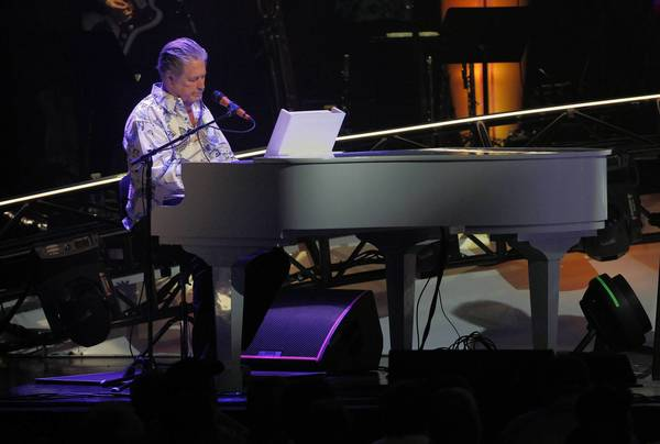 Brian Wilson plays piano during Monday's Beach Boys show at the Chicago Theater.