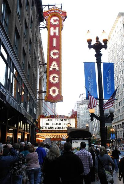 Concert goers wait in line for the Beach Boys show at the Chicago Theater.