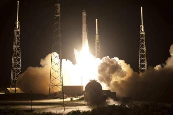 The SpaceX Falcon 9 rocket carrying the Dragon capsule lifts off from the Cape Canaveral, Fla.