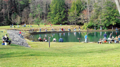 Anglers line the banks of Kooser Lake in this April 14 Daily American file photo. The swimming area at Kooser has been closed for the summer.
