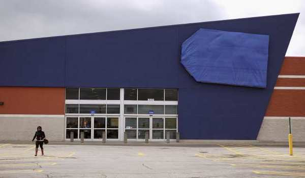 A person walks away from a shuttered Best Buy store in Chicago. The electronics retailer said income slid 26% in the first quarter.