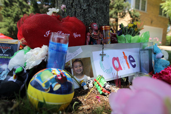 A memorial at the scene in Skokie where Carter Vo, 8, was killed while riding his bicycle on Monday.