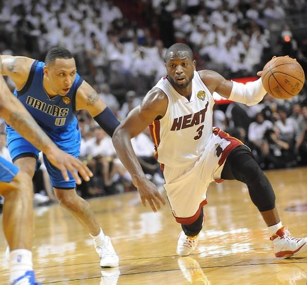 The Miami Heat's Dwyane Wade dribbles past the Dallas Mavericks' Shawn Marion in Game 2 of the NBA Finals at the AmericanAirlines Arena in Miami, Fl.
