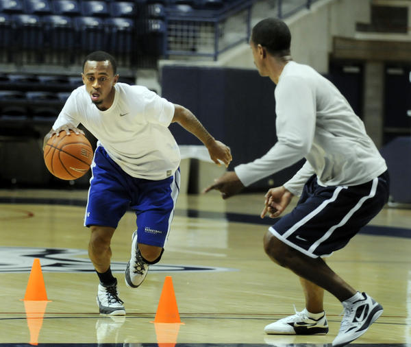 UConn's Ryan Boatright, left, works out under the watchful eye of  assistant coach Kevin Ollie during a one-on-one workout at Gampel Pavilion on Tuesday.
