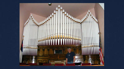 Art Faner of the First United Methodist Church in Meyersdale stands by the church's recently refurbished pipe organ which has been used for services since the church was built in 1903. An organ recital will be held at the church 3 p.m. Sunday by Mark Steiner. Steiner recently repaired the historic organ.