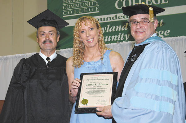 From left, David Moats, Hagerstown Community College Alumni Association president, Jaime Lynn Mason, and Guy Altieri, HCC president.