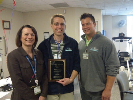 Brian White, center, City Hospitals March Quality Service Award winner, is pictured with Brenda Allen, rehab services director, left, and Brent Garrett, director of The Wellness Center.
