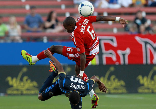Jackson Goncalves of FC Dallas goes over the Union's Raymon Gaddis for a header.