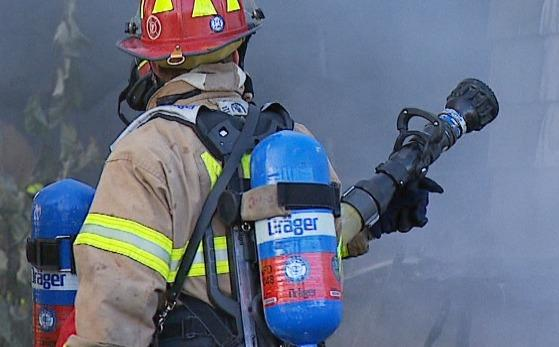 In this KTUU file image, an AFD firefighter is wearing a Draeger self-contained breathing unit.