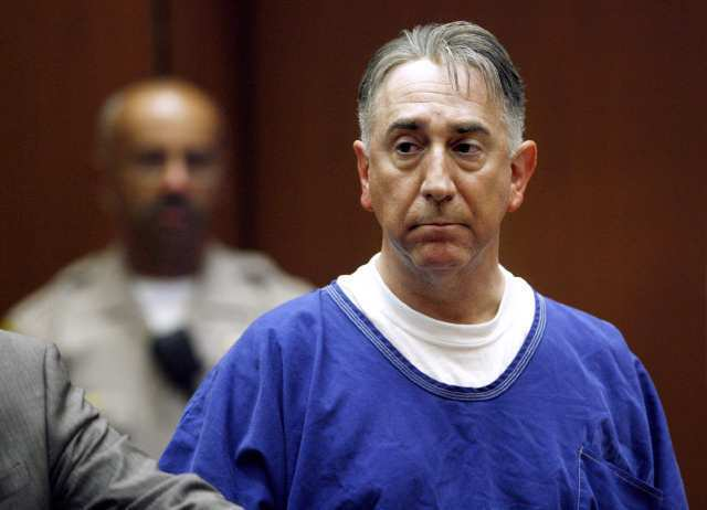 Former Glendale City Councilman John Drayman looks over to the District Attorney's side as he appears before a judge at the C.S. Foltz Criminal Justice Center for a bail hearing in Los Angeles. Drayman's friends paid the bail for his release.