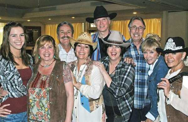 Enjoying an evening of western-themed fun and fundraising are, from left, Jessica and Carol Thielemann, Teri and Dan Sumner, Brooks and Ann Gardner, Victor and Donna Salant and Max Andrews.