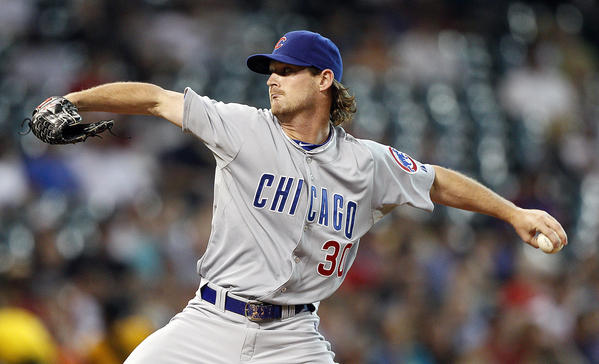 Cubs starter Travis Wood delivers in the first inning Tuesday night at Minute Maid Park.