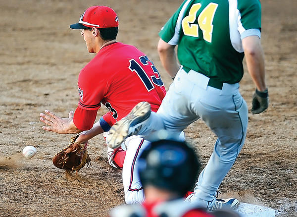 North Hagerstown's Andrew Yacyk (13) gets the late throw at first base as North Harford's Cody Brittain is safe in the top of the third inning of Tuesday night's Maryland Class 3A state semifinal baseball game at Joe Cannon Stadium.