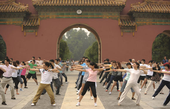 People perform exercises at the Working People's Cultural Palace