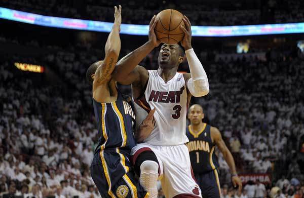 Miami Heat guard Dwyane Wade is fouled by Indiana Pacers guard George Hill during the third quarter of their Round 2, Game 5 playoff game, Tuesday, May 22, 2012, at AmericanAirlines Arena.