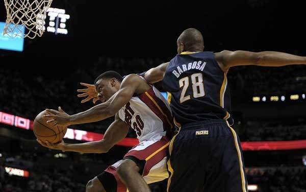 Miami Heat guard Norris Cole tries to get a shot off in front of Indiana Pacers guard Leonard Barbosa during the third quarter of their Round 2, Game 5 playoff game, Tuesday, May 22, 2012, at AmericanAirlines Arena.