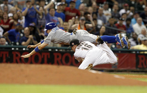 Tony Campana dives for third over the Astros' Matt Downs after advancing on a wild pickoff throw in the eighth.