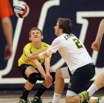 Emmaus' Eric Wiscount (6) left, and teammate Jake Reynolds (2) right, returns a serve against Northampton High School during their District 11 boys high school volleyball semifinal game Tuesday night.