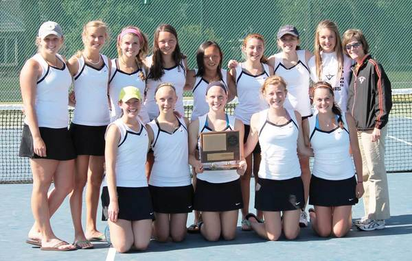 Harbor Springs High School girls tennis team members display their first-place trophy Tuesday after winning the Lake Michigan Conference Championship Tournament at Traverse City Central High School. Team members are front (from left) Claire Cunningham, Emily Lesky, Grace Carbeck, Perry Bower, Abbey Knoodle.; back, Morgan Mooradian, Liza Wilkes, Eva Zoerhof, Lily Dart, Leah Collie, Rae Claramunt, Maggie Kane, Hadley Cunningham and coach Laura Chamberlin