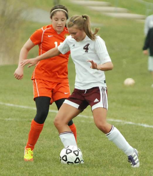 Sophie Seitz (left) of Harbor Springs and Carolena Elowsky of Charlevoix battle for possession of the ball during an April 30 match. The Rams and Rayders will meet 7 p.m. Thursday, May 24, at Ottawa Stadium in Harbor Springs to determine the Lake Michigan Conference girls soccer champion.