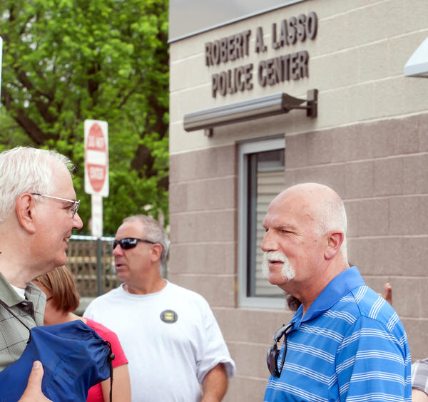 Donald Lasso (right), father of slain Freemansburg Officer Robert Lasso, talks with a friend during the borough's new Police Building Dedication on Tuesday afternoon. The building was dedicated as the Robert A Lasso Police Center after slain officer Lasso. George Hitcho Jr. was found guilty of first degree murder last week in the shooting of Officer Lasso last August 11th, 2011 as he responded to a dispute Hitcho had with a neighbor.