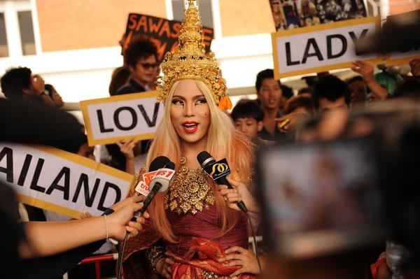 A fan of US pop diva Lady Gaga answers reporters' questions as she waits for her arrival at Bangkok's Don Mueang airport on May 23, 2012.  Lady Gaga arrived in Thailand as part of her world tour.